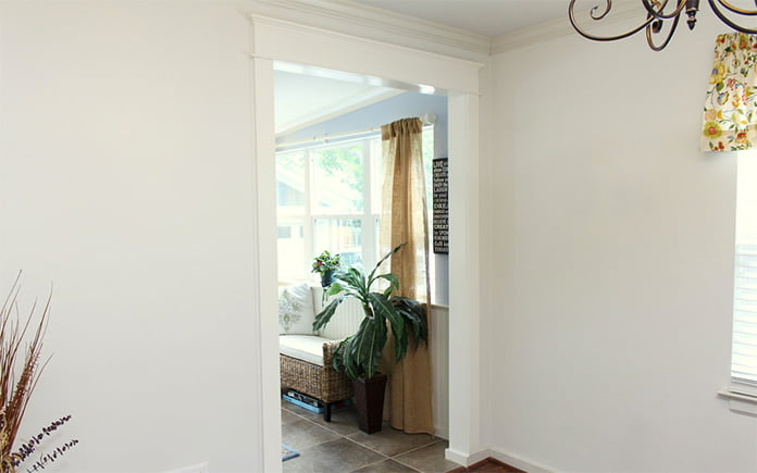 Wood trim on a cased opening in Chelsea Lipford Wolf's dining room