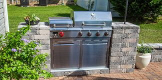 Beautiful Dyna-Glo gas grill with Pavestone grill surround