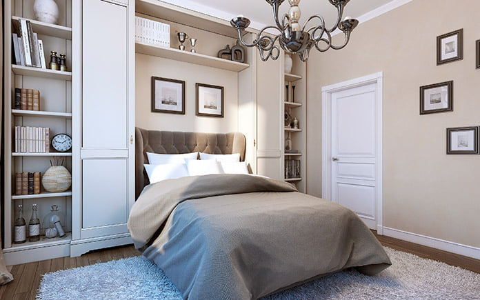 Beautiful, luxurious bedroom with an upholstered headboard and a chandelier