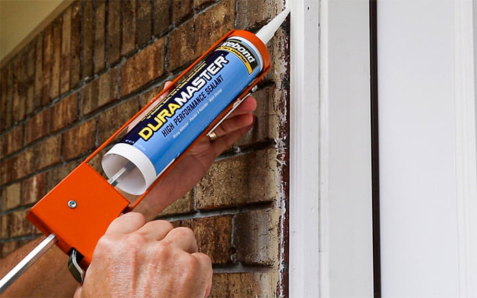 Caulking a gap in the doorway with Titebond DuraMaster sealant
