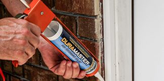Caulking a gap in the doorway outside a home with Titebond DuraMaster sealant