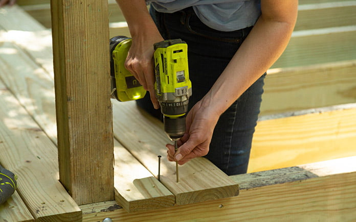 Chelsea Lipford Wolf installs YellaWood deck boards