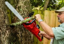 Dan from The Home Depot in Mobile, Alabama, cuts a limb with the Milwaukee M18 FUEL chainsaw