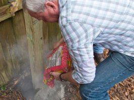 Danny Lipford pours Quikrete Fast-Setting Concrete Mix into post hole