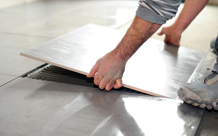 Installing ceramic tile flooring over vinyl flooring and concrete adhesive