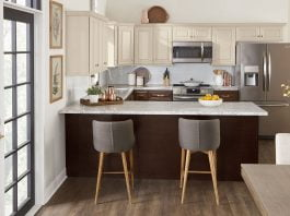Kitchen with breakfast bar and beautiful cabinets from Cabinets To Go