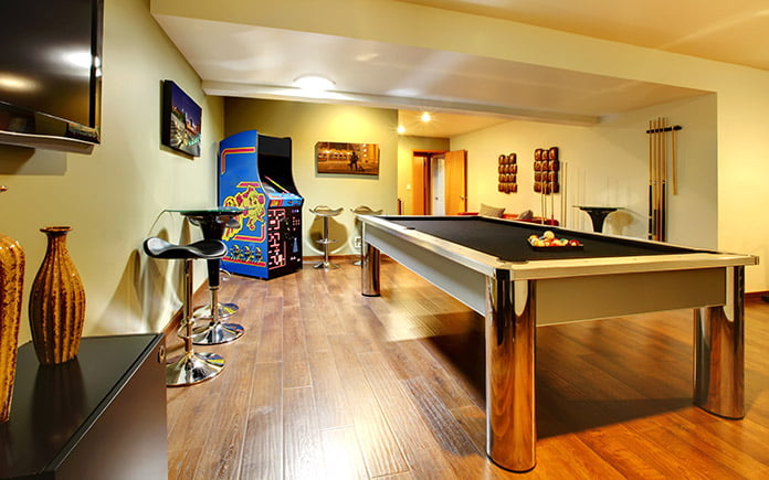 Man cave, complete with an arcade game, pool table and masculine furnishings