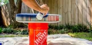 Applying outdoor fabric spray paint to cushion