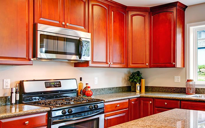 Cherry wood cabinets in a kitchen photographed in 2015