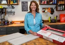 Jodi Marks, of Today's Homeowner, stands beside a box of Daltile porcelain tiles in a workshop