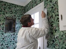 Man paints wallpaper