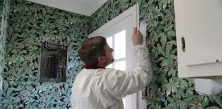 Man paints wallpaper
