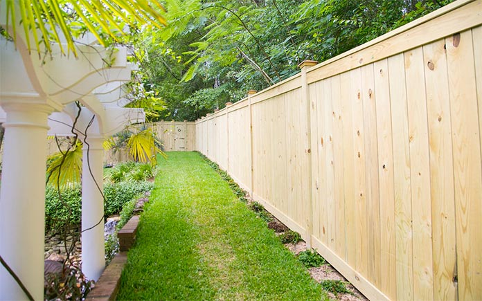 Newly installed wooden fence in a luxurious backyard