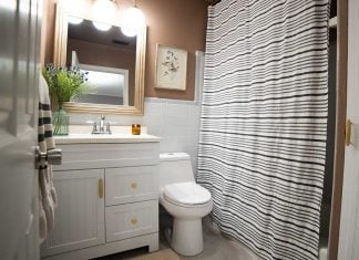 Beautiful modern bathroom with painted walls and new toilet and porcelain tile floors