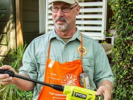 Dan, a Home Depot employee, demonstrates the Ryobi power cleaner in a backyard, during a segment of Today's Homeowner.