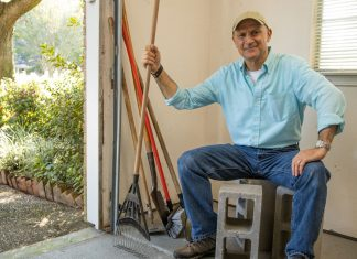 On a Simple Solutions segment of Today's Homeowner, Joe Truini prepares to demonstrate how to use three cement blocks to store garden tools in a garage.