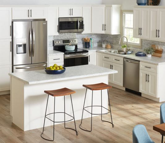 White shaker-style cabinets seen in a modern kitchen with the latest trends for 2020