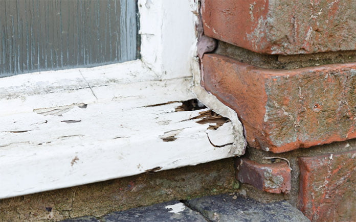 Rotted wood window sill on an otherwise attractive brick home