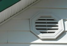 Closeup of a home with a gable vent and soffit vents