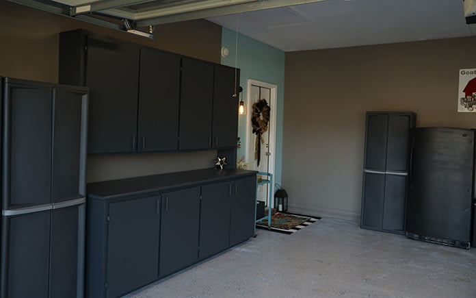 Mint green accent wall, seen from the side in a garage