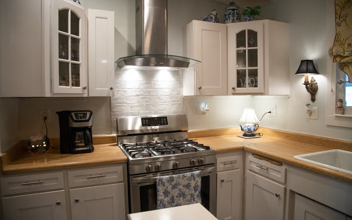Kathrin Luton's kitchen, after its renovation with a new range hood and backsplash, in Palmdale, California.