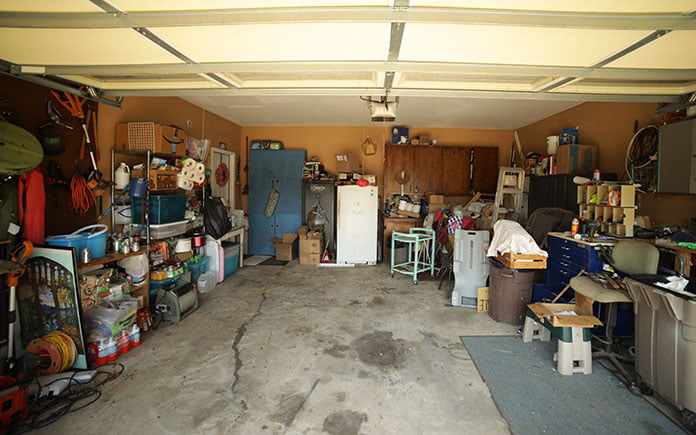 Unorganized garage, seen before a renovation