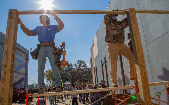A construction crew builds a stage at Lafayette Landing Park in Marianna, Florida