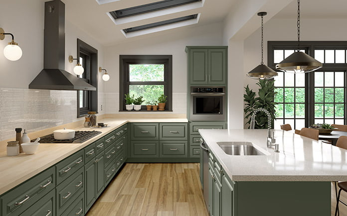 Cabinets To Go's Montpelier Sage Raised Panel Collection, as seen in a kitchen showroom in 2021.