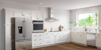 Remodeled modern kitchen, featuring Worthington White designs, as seen in a Cabinets To Go showroom.