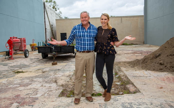 """Today's Homeowner"" hosts Danny Lipford and Chelsea Lipford Wolf, standing at a pocket park in Marianna, Florida"