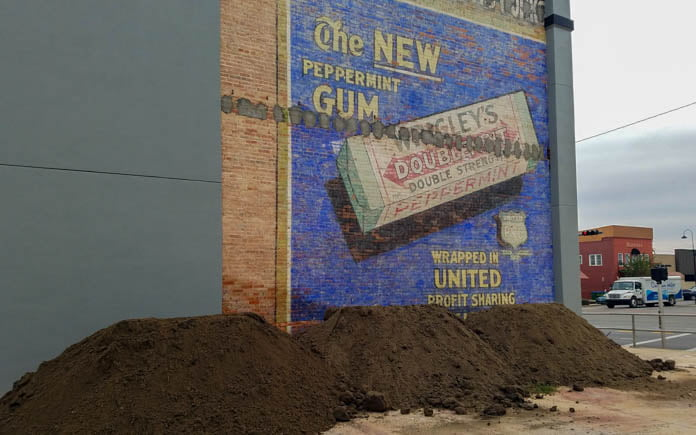 1920s mural featuring Wrigley's New Peppermint Gum and an ad for United Profit Sharing coupons