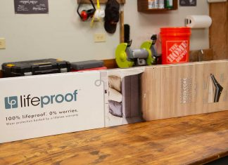 In a Best New Product segment of Today's Homeowner, Jodi Marks stands in a workshop holding the Home Depot product Lifeproof Luxury Vinyl Wood Plank Flooring.