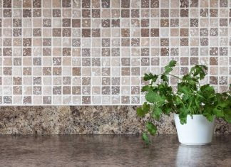 Ceramic tile backsplash with granite countertop in a modern kitchen
