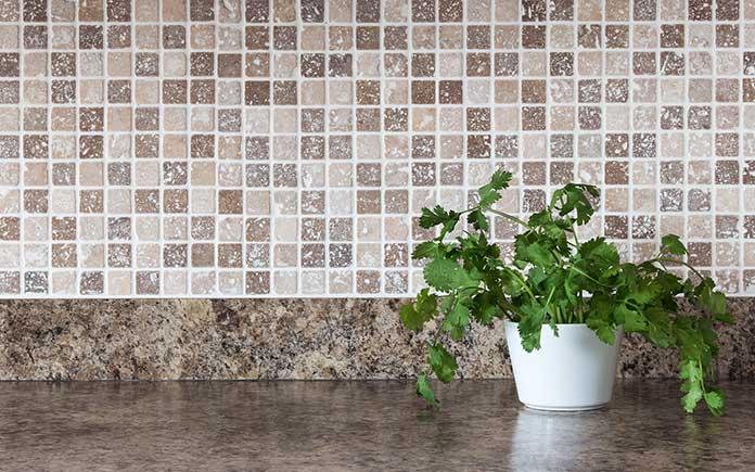 Ceramic tile backsplash with granite countertop in a modern kitchen