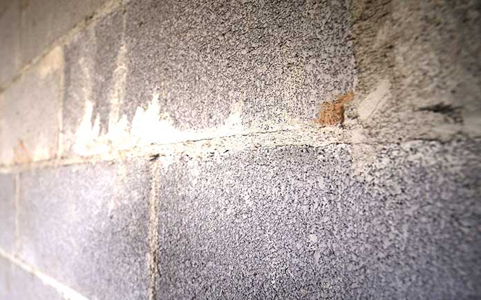 Concrete wall stained with efflorescence