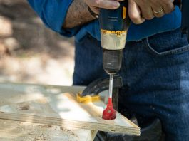 Simple Solutions host Joe Truini drills holes in plywood