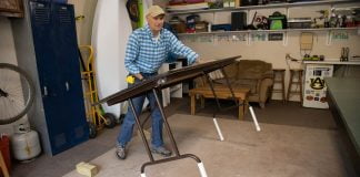 In a Simple Solutions segment of Today's Homeowner, Joe Truini attaches pipes to the legs of a folding table to make it into a taller and more comfortable surface to work on.