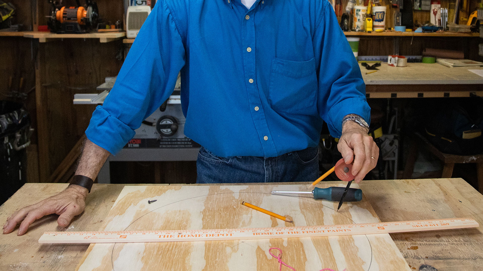 A yard stick, a pencil compass and a piece of wood, as seen in the Simple Solutions segment on Today's Homeowner TV