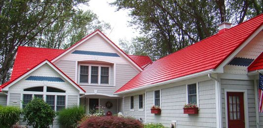 Red metal roof on a white wood house