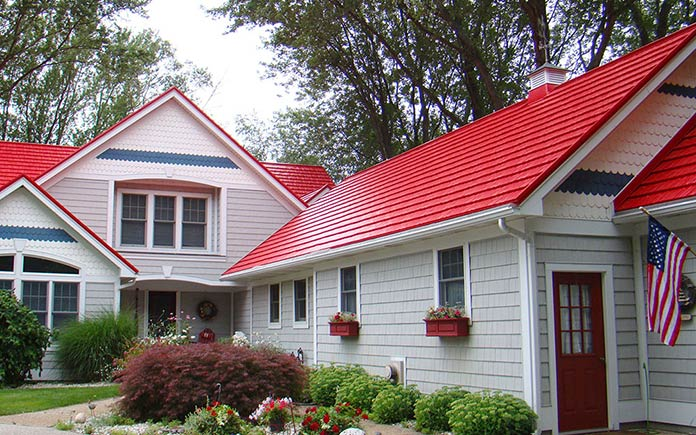 Red metal roof, as seen on a white wood house in Michigan