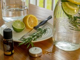DIY mosquito repellant ingredients: lemon, lime, rosemary, oil, candle, water, mason jar