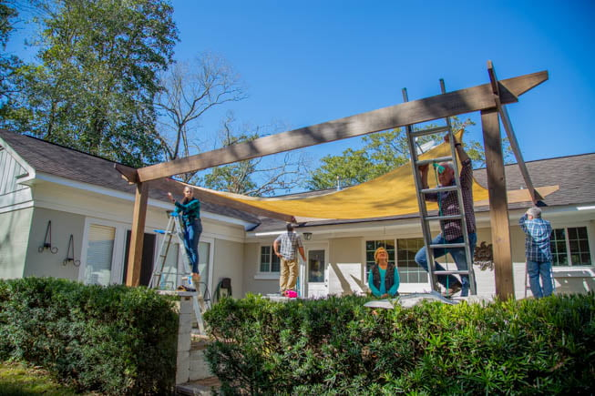Today's Homeowner crew installs a shade sail over a wood pergola