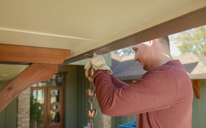 Marc Ingram installs a rain chain at Today's Homeowner host Danny Lipford's home