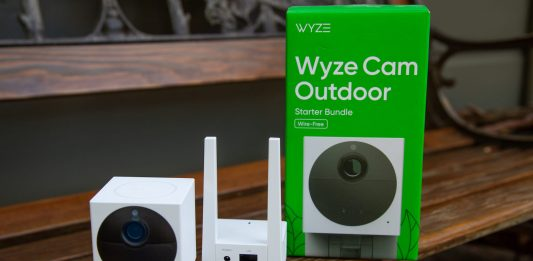 Wyze outdoor home security camera sitting on a bench