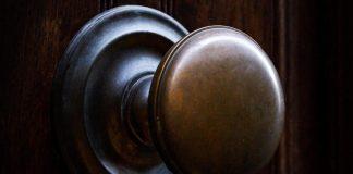 brass doorknob on wooden door