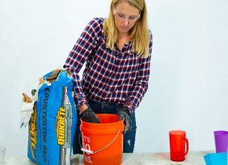 """Today's Homeowner"" host Chelsea Lipford Wolf mixes concrete on a table"