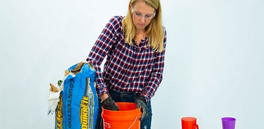 """""""Today's Homeowner"""" host Chelsea Lipford Wolf mixes concrete on a table"""
