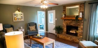Updated family room with green walls and dark wood floors