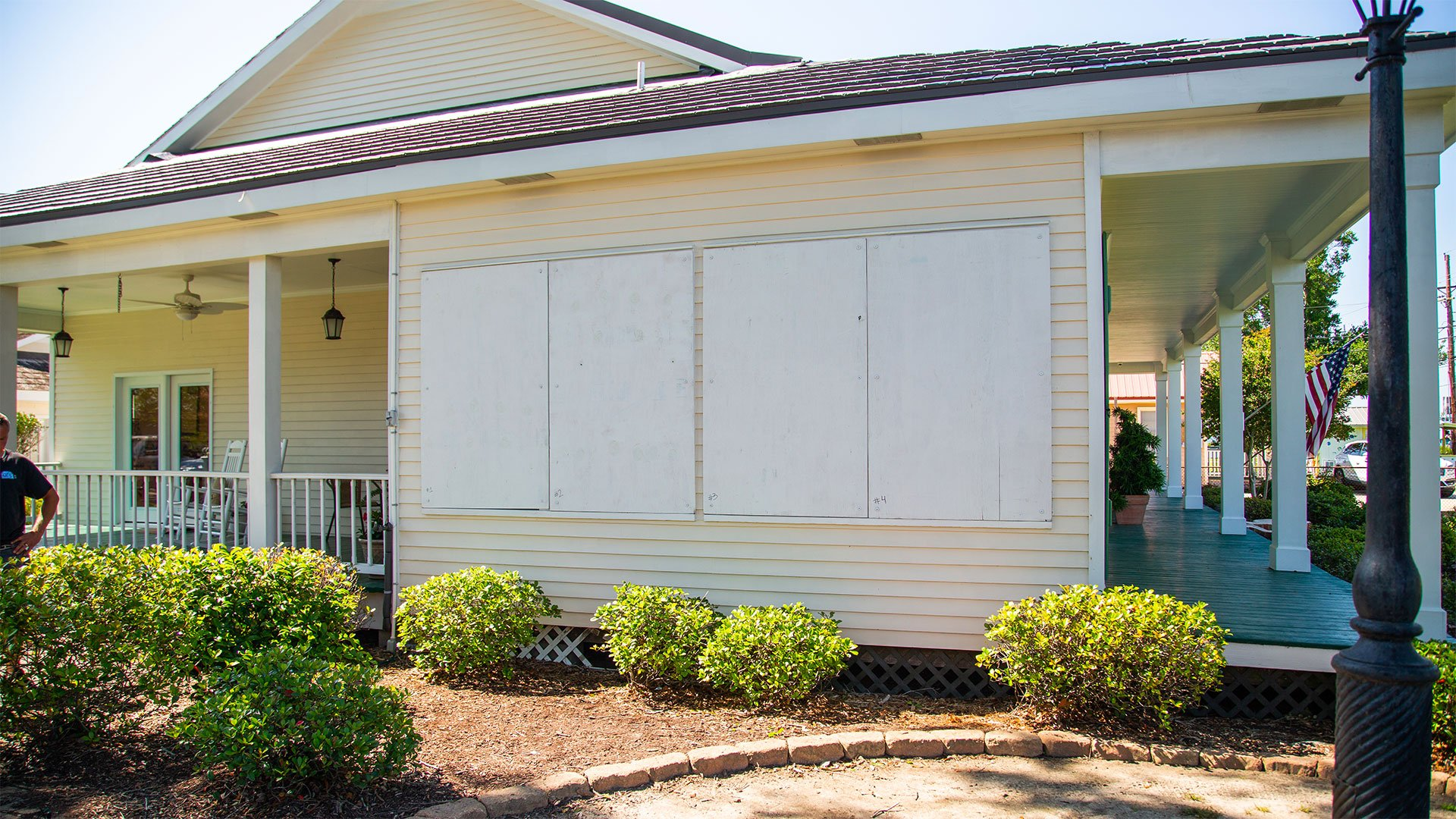 Louisiana home, seen with hurricane shutters