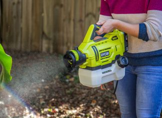Ryobi Electrostatic garden sprayer is used to spray a plant in a backyard